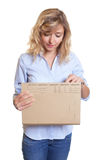 Secretary with curly blond hair looking at file Royalty Free Stock Photo
