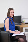Secretary at desk Stock Images