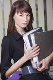Secretary with document folders. Female secretary with document folders in the office Royalty Free Stock Photography