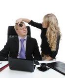 Secretary doing make-up to the boss Stock Image