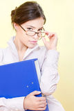 Secretary with eyeglasses holding file Royalty Free Stock Images