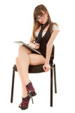 Secretary with folder sitting on chair Stock Photography