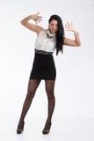 Secretary girl. Beautiful girl in a mini skirt and white blouse Stock Image