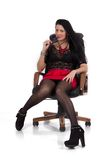 Secretary girl in the chair. Beautiful girl in a mini skirt and black blouse sitting in chair Stock Photos