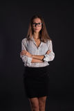 Secretary girl. In glasses on a black background Royalty Free Stock Image