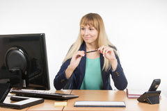 Secretary Girl looks in the computer monitor for office table Royalty Free Stock Images