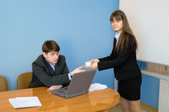 Secretary gives a cup to the chief Royalty Free Stock Photo