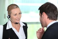 Secretary giving information to boss Royalty Free Stock Photography