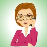 Secretary with glasses talking on phone Stock Photo