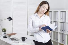 Secretary going through her notes Stock Photos
