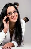 Secretary have a call. Beautiful young secretary is having phone conversation Stock Photo