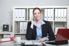 Secretary having a call Royalty Free Stock Image