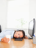 Secretary with headset sleeps in office Stock Image