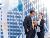 Secretary helping boss Confident business partners consulting in city background. Stock Images