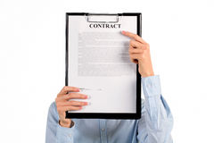 Secretary hiding face behind clipboard. Royalty Free Stock Image