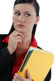 Secretary holding a binder Royalty Free Stock Images