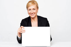 Secretary holding laptop flap, about to close Stock Images