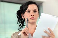 Secretary holding a notepad Stock Photo
