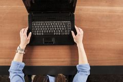 The secretary holds the computer with both hands, view from above royalty free stock photography