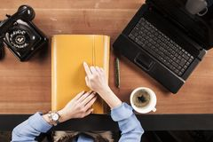 Secretary holds confidential documents on the desk, view from ab stock image