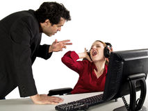 Secretary ignoring her boss Royalty Free Stock Photography