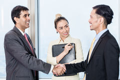 Secretary introduces applicant to boss for job interview Royalty Free Stock Photo