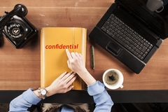 Secretary keeps confidential documents on her desk, view from ab royalty free stock photo