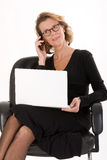 Secretary with laptop and mobile phone Stock Photo