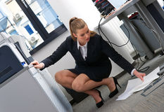 secretary lifting papers from the floor Royalty Free Stock Images