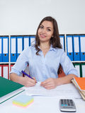 Secretary with long dark hair at office Royalty Free Stock Images