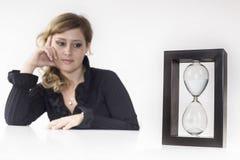 Secretary look an hourglass Stock Photo