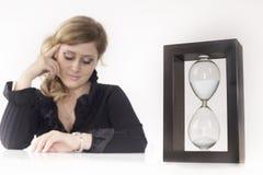 Secretary look the watch Royalty Free Stock Photo