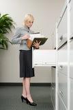 Secretary looking at files Stock Photos