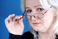 Secretary looking over glasses Stock Image