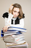 Secretary with a lot of documents. Tired secretary with a lot of documents stock photos