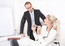 Secretary making manicure at office and surprised boss. Royalty Free Stock Photos