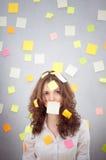 Secretary with many notes Stock Photo