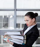 Secretary  in the office. Tired secretary with a lot of documents Stock Image