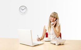 Secretary on phone. Secretary with a telephone in the office Stock Photos