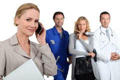 Secretary on phone with mechanic. Doctor and hairdresser �?? close-up Royalty Free Stock Image