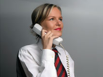 Secretary with phones Royalty Free Stock Photo