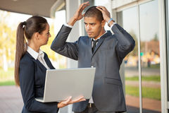 Secretary pointing at the laptop Director bad news Royalty Free Stock Image
