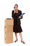 Secretary Postal  Package telephone. Female employee, secretary next to postal package with telephone on top, making a phone call. Studio, white background Stock Photos