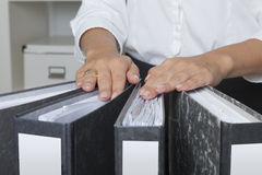 Secretary prepared some folders with invoices. Hands on four folders filled with files in office environment Royalty Free Stock Images
