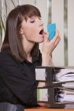 Secretary putting makeup Stock Image