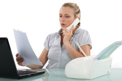 Secretary questioning a fax Stock Image