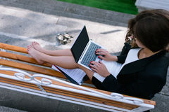 Secretary at remote job. Student typing outdoors. Young girl doing business documentation top view Royalty Free Stock Photo
