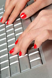 Secretary s hand typing on a computer keyboard Royalty Free Stock Image