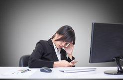Secretary sat in tense posture Due to the complex and difficult task Stock Photos