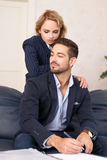 Secretary seduce businessman in office. Relationship between young business people Stock Photos